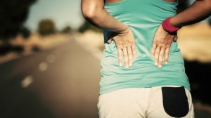 Female-runner-athlete-back-injury-and-pain-585x329