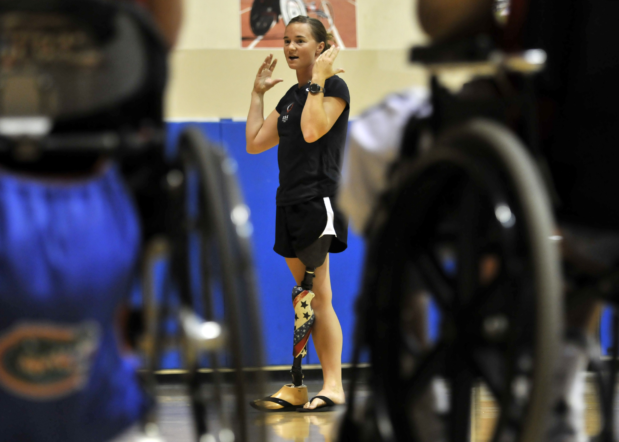 Former Army soldier Melissa Stockwell, speaks to fellow injured service members during one of the annual Paralympic Military Sports Camps at Balboa Naval Medical Center in San Diego.